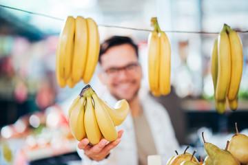 Selling bananas at farmer's market.