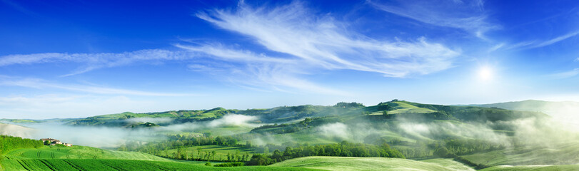 Wall Mural - Idyllic view, foggy Tuscan hills at sunrise