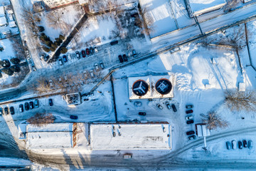 View of the urban industrial district from the air. Winter cityscape.
