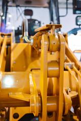 The mechanism of raising the bucket, wheel bucket loader close up