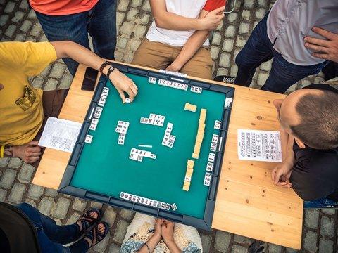 People Playing Mahjong Asian Tile-based Game. Table Gambling top view
