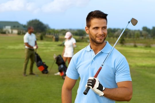 Outdoor portrait of male golfer with golf club