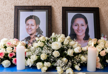 Portrait photographs of Sara Gebremichael, a senior hostess and a crew leader on the Ethiopian Airlines Flight ET 302 plane that crashed are seen at her house in Addis Ababa