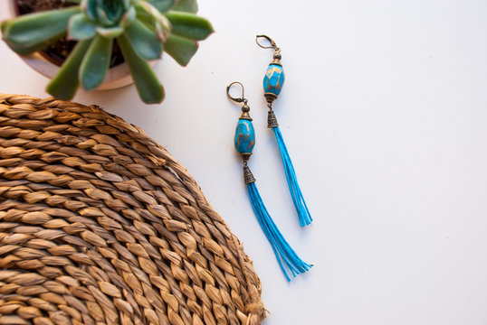 Bohemian style turquoise bronze tassel earrings. Fashion background with space for text.