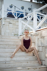 Sensual woman sitting on pier
