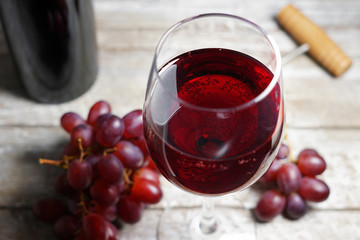 Red Wine Glass On Wooden Table
