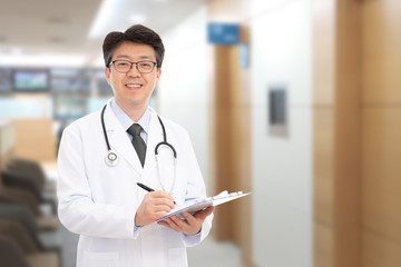 Asian male doctor smiling in the background of the hospital