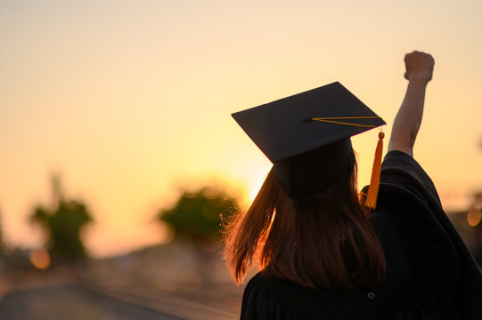 Graduates wear a black dress, black hat at the university level.