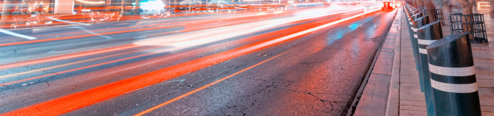 Foto op Canvas Las Vegas Car light trails at night on a main city avenue