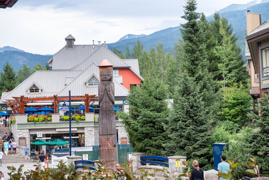WHISTLER, CANADA - AUGUST 12, 2017: Tourists enjoy city center on a summer day. Whistler is a famous mountain destination in British Columbia
