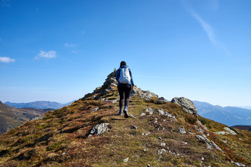 "Woman hiking on Mountain ""Schwendberg"" in austrias alps / Nice paths, peaks and lakes in Zillertal"
