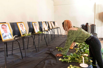 A member of the Ethiopian Airline Pilots' Association mourns as she attends a memorial service for the Ethiopian Airlines Flight ET 302 plane that crashed, in Addis Ababa