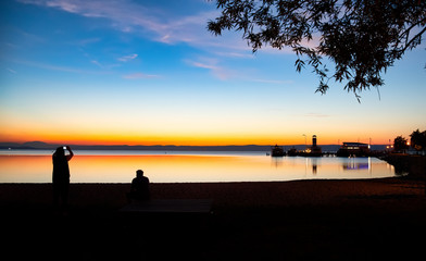 Silhouette of people on the beach in Podersdorf