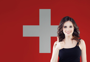 Love Switzerland. Happy woman on swiss flag background