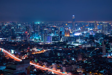 Bangkok aerial skyline at night from drone view.