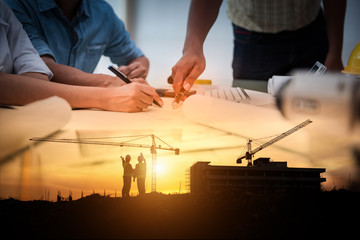Civil Engineer Jobs, Double exposure of Project Management Team and Construction Site with tower crane background, Day and Night shift on employees job concept. Wall mural