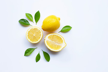 Lemon and slices with leaves isolated on white. Fototapete