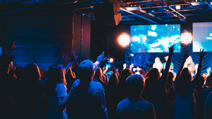 crowd of people at worship concert