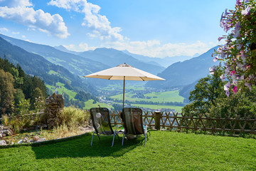 Lounge Chairs and Parasol with stunning view over Valley of Zillertal in Tirol in Austria
