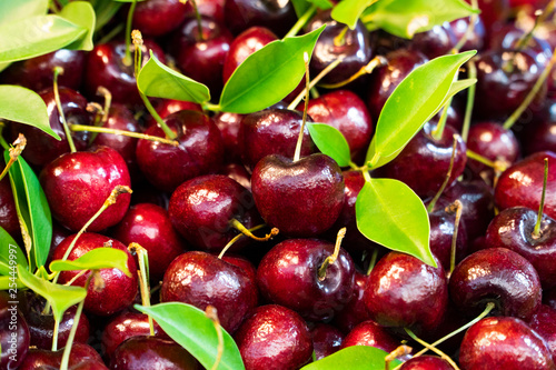 Fresh cherries pile up at a stall to sell in the market