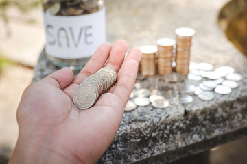 Save money concept with hand holding coins
