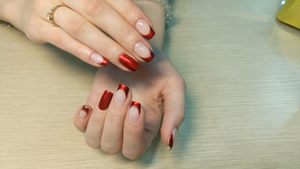 Foto auf Leinwand Maniküre Beautiful female hands with a red nail design