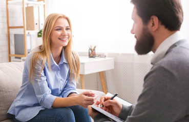 Smiling woman during consultation with life coach