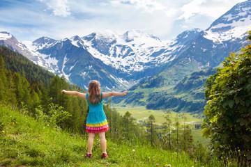 Children hiking in Alps mountains. Kids outdoor.