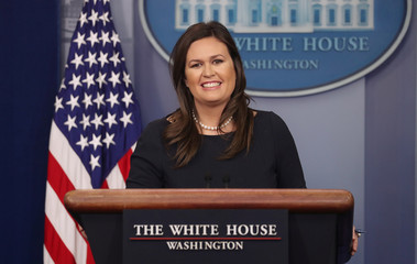White House Press Secretary Sanders smiles as she holds press briefing at the White House in Washington