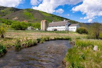 White barn with stream