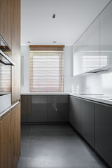 Simple kitchen with wooden blinds