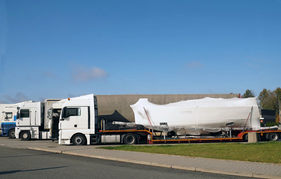 Truck with a special trailer for boat transport. Land transport of boats and yachts.