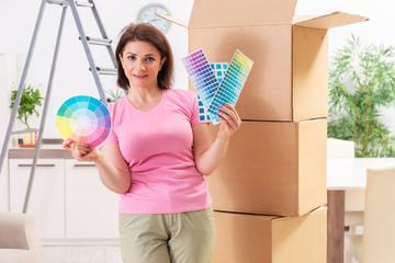 Woman choosing color for flat renewal