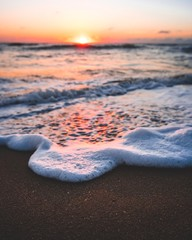 sea foams during sunset