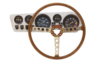 Vintage car steering wheel and cockpit with meters isolated on white