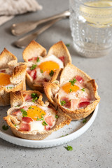 Baked egg, bacon and toast cup for breakfast brunch.