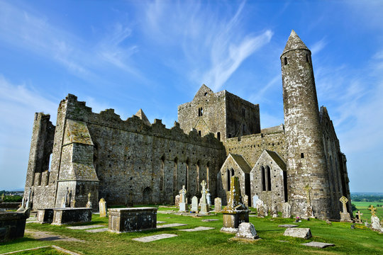 Famous ancient ruins of the Rock of Cashel. Close up view with tower from the old burial grounds.