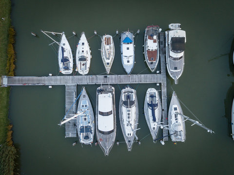 eleven sail boats dock on pier