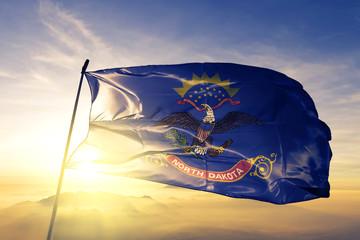 North Dakota state of United States flag waving on the top sunrise mist fog Wall mural