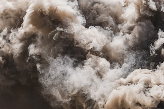 Pyrotechnic means for start-up smoke. Hand smoke grenade. Smoke bomb black. Gray smoke. The texture of the smoke. The area of the smoke. Fire. Pyrotechnics.