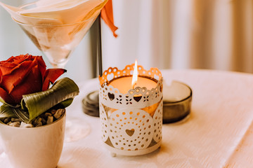 lighted candle on candle holder