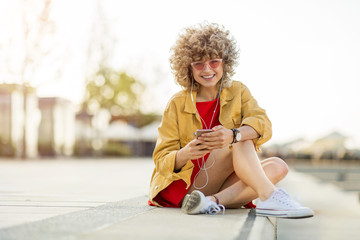Young woman with mobile phone in the city