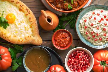 Georgian cuisine- Adjarian Khachapuri with cheese sulguni, chashushuli - a beef and tomato stew, Pkhali from eggplants and walnuts, adjika, Tkemali  souse.