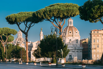 Rome, Italy. Via Dei Fori Imperiali Street In Sunny Summer Morning. View On Church Of Most Holy Name Of Mary At Trajan Forum