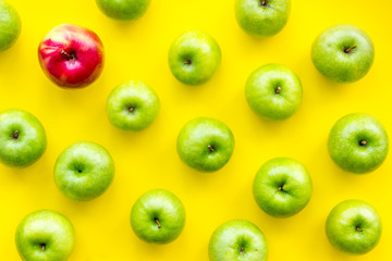 food pattern with green apples on yellow background top view