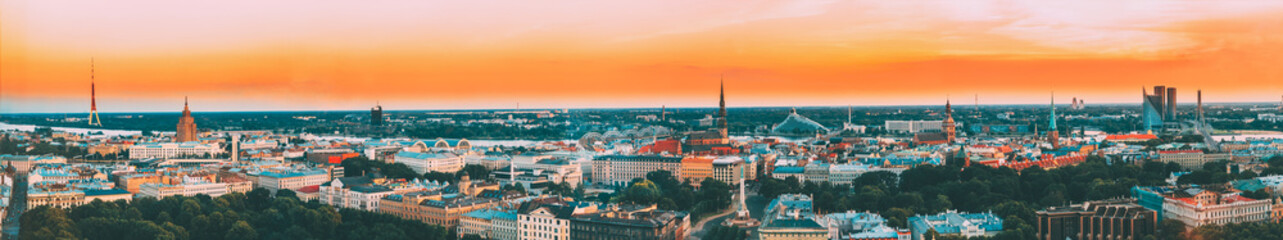 Riga, Latvia. Aerial View Panorama Cityscape At Sunset. TV Tower, Academy Of Sciences, St. Peter's Church, Boulevard Of Freedom, National Library, Dome Cathedral, Basilica Of St. James