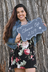Beautiful high school senior at the park. Posing for graduation pictures class of 2019.