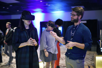 Danish Crown Princess Mary wears a Virtual Reality headset while participating in an interactive exhibit as she tours the South by Southwest (SXSW) conference and festivals in Austin