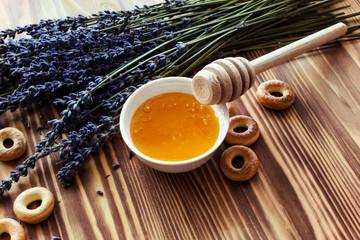 Lavender honey in jar. Healthy eating, natural sweet.