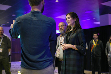 "Danish Crown Princess Mary listens to Jakob Steensen explain his interactive exhibit ""Re-Animated"" while touring the South by Southwest (SXSW) conference and festivals in Austin"